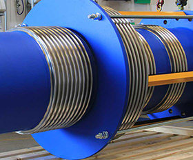 Tied pressure balanced expansion joint